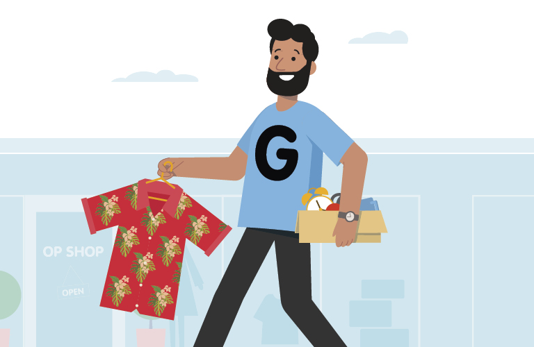 Man with 'G' (for gifting) on his shirt carrying an old shirt and items to give to charity